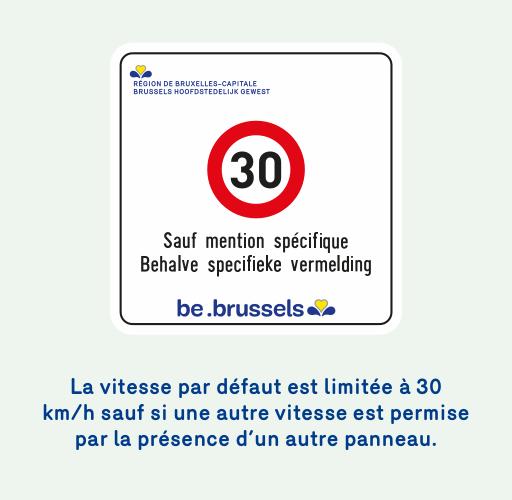 Image d'un panneau informatif qui indique que la vitesse par défaut est limitée à 30 km/h sauf si une autre vitesse est permise par la présence d'un autre panneau.